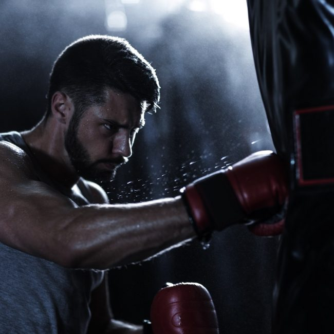 Cape Town, South Africa, male boxer practising in boxing gym